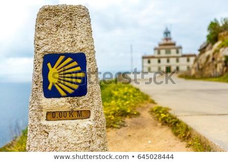 Saint James Way sign and lighthouse of Finisterre Stock photo © lunamarina