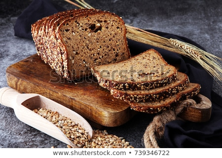 Closeup of whole grain bread with seeds on a rustic wooden board Stock photo © dash