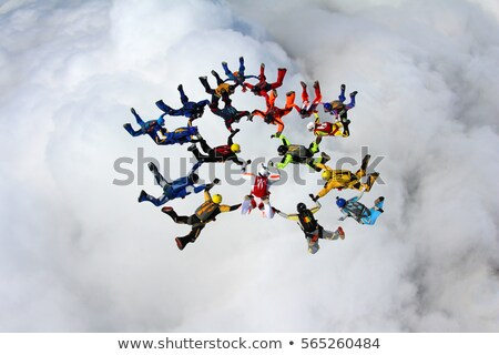 Skydivers group flying in the free fall. Stock photo © jossdiim