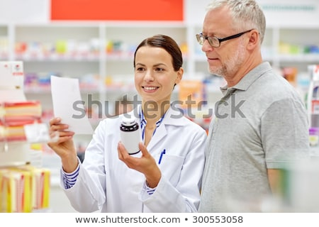 senior apothecary with prescription at pharmacy Stock photo © dolgachov