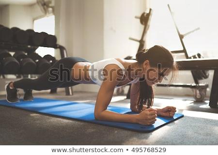 Stockfoto: Jonge · vrouw · oefening · gymnasium · sport · fitness · opleiding