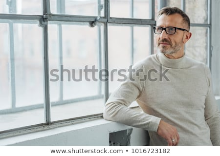 portrait of relaxed classy man looking to side stock photo © feedough
