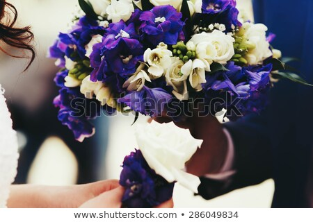 incredibly beautiful elegant stylish bridal bouquet with roses and purple flowers Stock photo © ruslanshramko