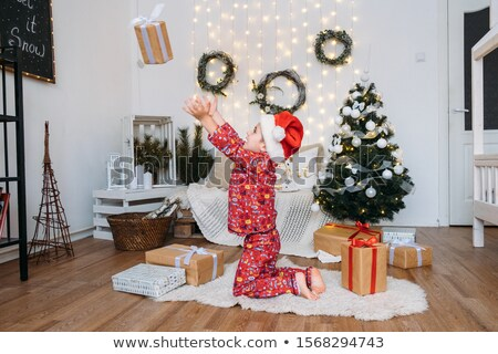 merry christmas boy unpacking gifts new year tree stock photo © robuart