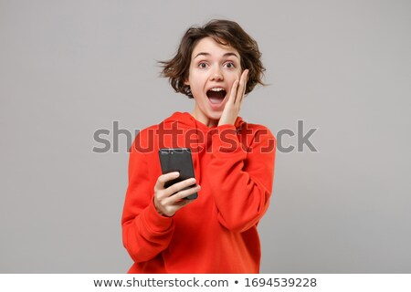 Portrait of a shocked girl wearing hoodie Stock photo © deandrobot