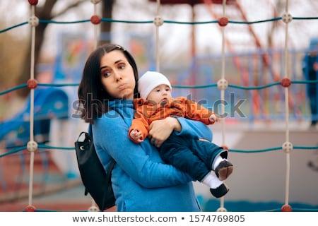Csintalan lány játszik fáradt anya boldog Stock fotó © AndreyPopov
