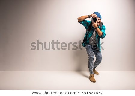 Fiatal fotós fotó felszerlés izolált férfi Stock fotó © robuart