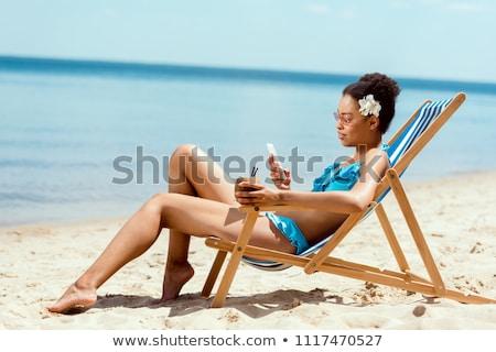 Młodych atrakcyjna kobieta relaks morza plaży jasne Zdjęcia stock © karandaev