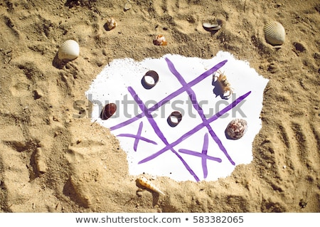 tic tac toe and wedding rings on the beach wedding in the tropics concept stock photo © galitskaya