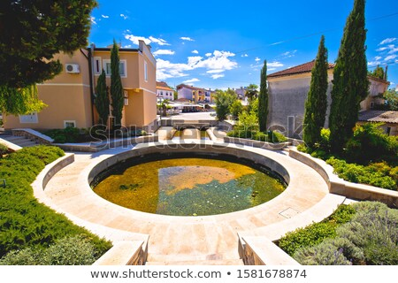 Krk island, Town of Malinska fountain and Riva waterfront view Stock photo © xbrchx