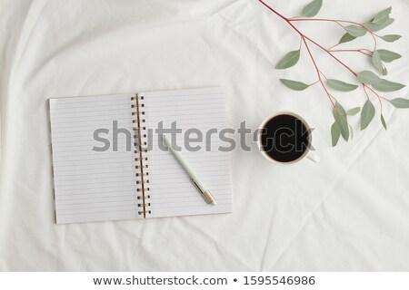 Open notebook pen beker zwarte koffie Stockfoto © pressmaster