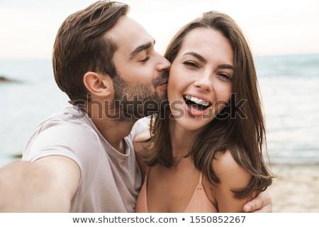 loving couple outdoors at beach walking stock photo © deandrobot