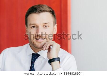 Jómódú fiatal férfi vállalkozó fehér póló Stock fotó © vkstudio