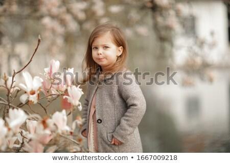 Fille ans vieux fleurs arbres femme Photo stock © ElenaBatkova