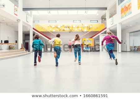 Students running to their classes in school main hall Stock photo © Kzenon