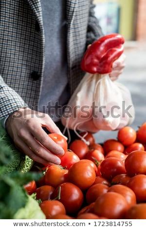 man using reusable mesh bags at a greengrocer Stock photo © nito