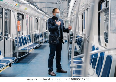 Coronavirus, Covid-19. Sick man feels unwell, has shortage of breathing, wears medical mask, poses i Stock photo © vkstudio