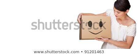 mulher · atraente · caixa · remoção · sorrir · adolescente - foto stock © HASLOO