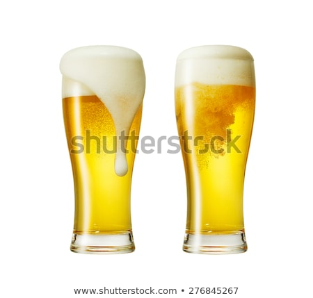 Beer glass with froth over yellow background Stock photo © ozaiachin