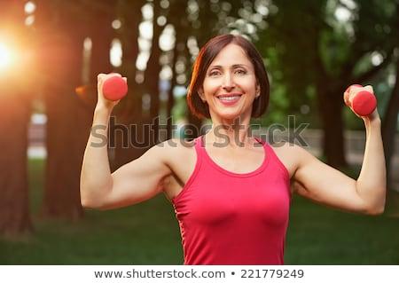 Nő piros súlyzó izolált fehér lány Stock fotó © Nobilior