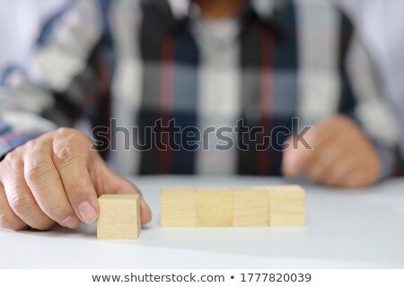Construction toys, a symbol of success, and a businessman's hand stock photo © justinb