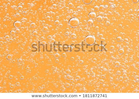 Golden macro background: gas bubbles in beer Stock photo © lightpoet