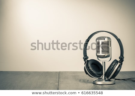 Disc jockey with headphones and microphone Stock photo © broker