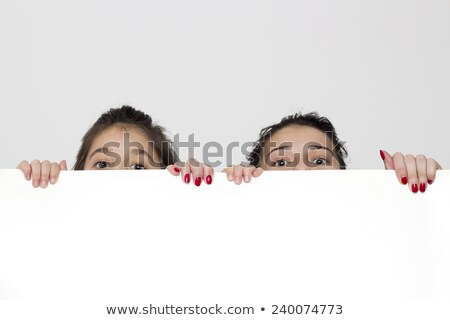 Brown-haired girl holding white panel for message Stock photo © photography33