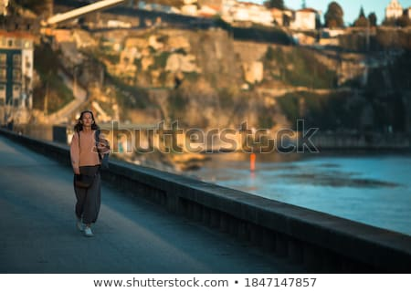 Young beauty on a evening walk Stock photo © konradbak