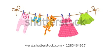 A set of children's clothes hanging on a clothesline. Stock photo © RuslanOmega