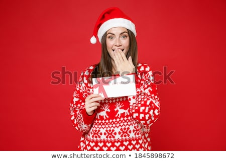 female santa holding a christmas white card stock photo © nobilior