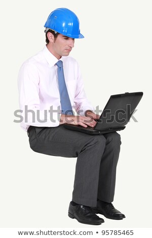 Architect sat typing notes on laptop Stock photo © photography33