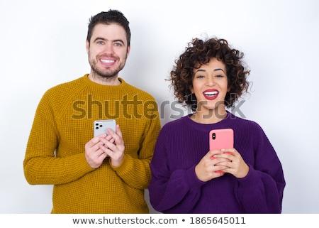 Young couple against the mirror Stock photo © konradbak