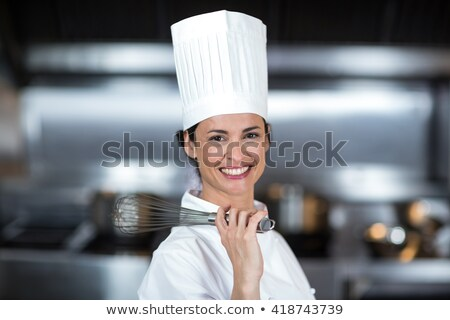 Mature chef holding wire whisk Stock photo © wavebreak_media