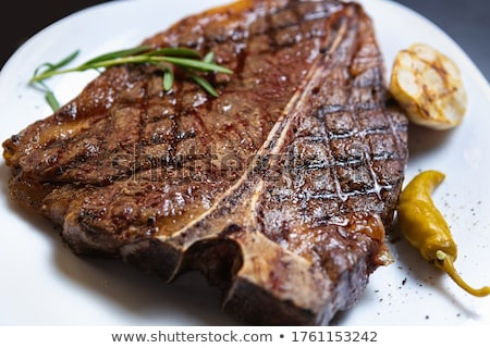 Steak dinner on white plate. Stock photo © DonLand