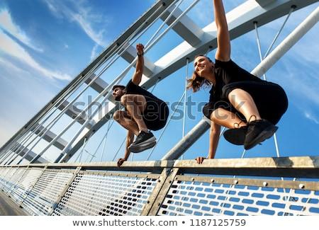 beautiful athletic couple over black stock photo © photobac