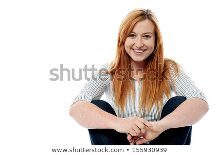 Beautiful girl in casuals, sitting idle Stock photo © stockyimages