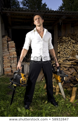Muscular man with a chainsaw Stock photo © vlad_star