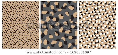 Brown and Black Leopard Print Textured Fabric Background Stock photo © karenr