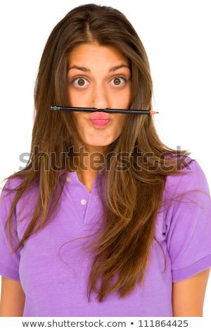 teenage girl balancing pencil on her lip stock photo © ambro