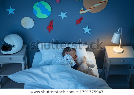 High angle view of a boy sleeping on the bed Stock photo © bmonteny