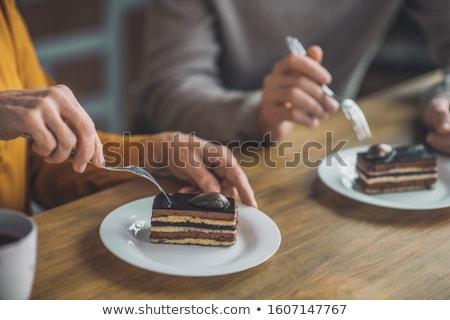 Férfi eszik desszert villa fiatalember bent Stock fotó © feelphotoart