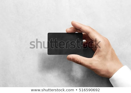 Businessman holding blank visiting card with rounded corners Stock photo © stevanovicigor