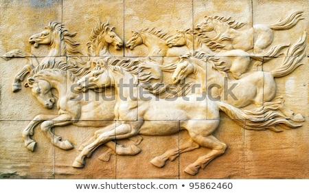 Belle sculpture pierre jaune mur européenne Photo stock © Witthaya