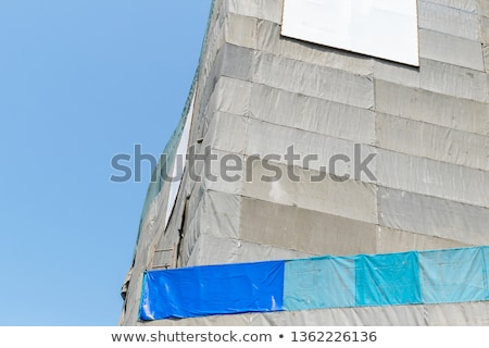 High rise building covered in white tarpaulin. Stock photo © latent