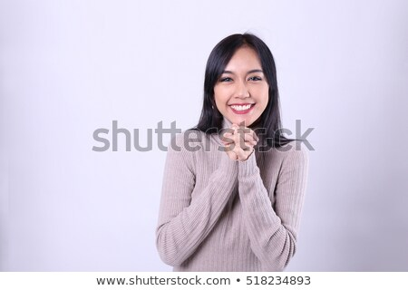 Exciting Christmas woman praying Stock photo © elwynn