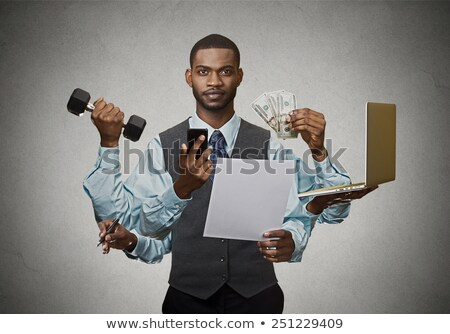 fitness man working out with small dumbbells stock photo © deandrobot