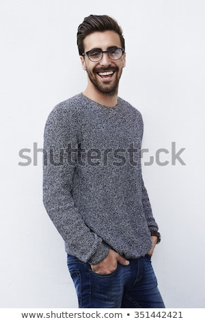 Handsome hipster with hands in pocket looking at camera Stock photo © wavebreak_media