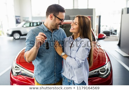 Young couple with a car dealer. Stock photo © Kurhan