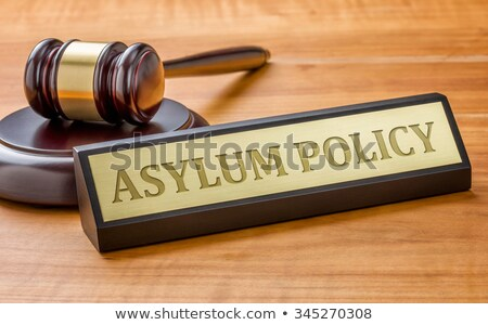Stock photo: A gavel and a name plate with the engraving Asylum Policy